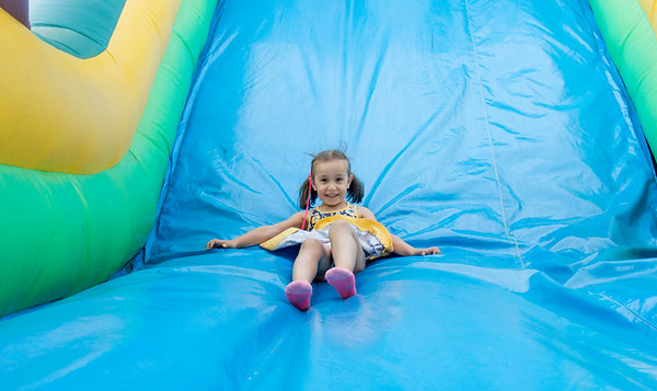 06/28/19 Wesley Bunnell | Staff The Sacred Heart Partish Festival, Odpus, opened Friday June 28, 2019 and will continue thru Saturday. Nadia Morz, age 5, slides down an inflatable at the festival.