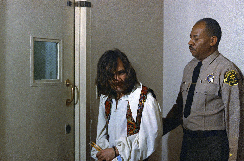 . Hippie cult leader Charles Manson, who is accused in multiple murders, is shown on his way to court, Jan. 27, 1970.  (AP Photo/David F. Smith)