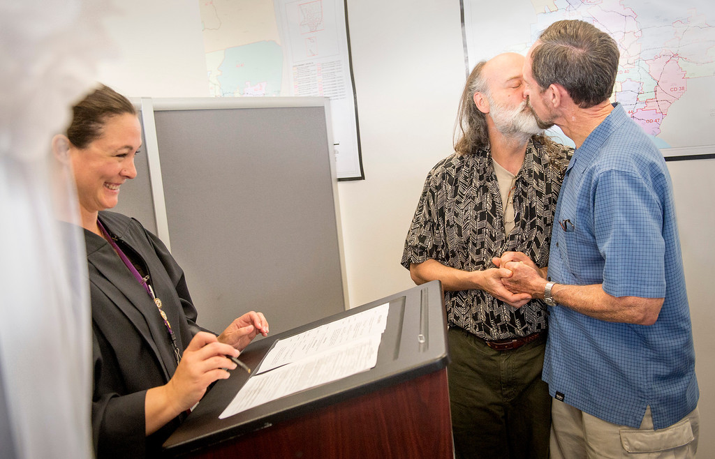 . Lee Conger, 56, left, and John Wingler, 66, of Silverlake embrace and kiss after exchanging vows during a civil ceremony performed by deputy commissioner Brandy Corona at the Los Angeles County Registrar-Recorder/County Clerk office in Norwalk, Ca. July 1, 2013.   (SGVN staff photo by Leo Jarzomb)