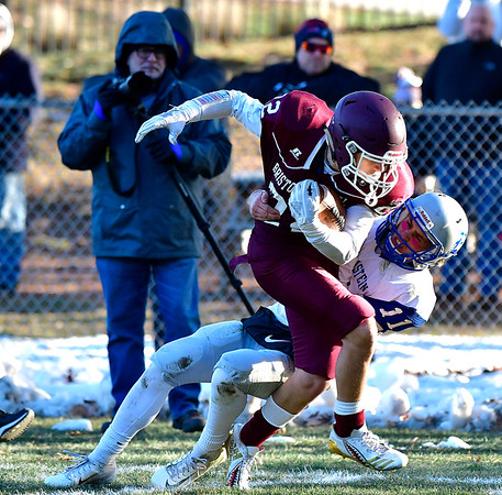 11/23/2018 Mike Orazzi   Staff Bristol Central's Victor Rosa (22) and Bristol Eastern's Justin Marshall (11) during the Battle for the Bell at Muzzy Field Friday. Central won 24-19.