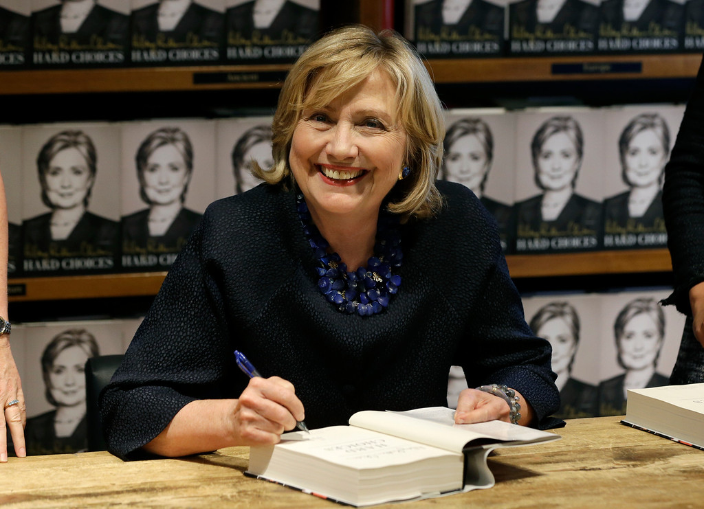 . Hillary Rodham Clinton signs copies of her book Hard Choices at Books & Books bookstore, Thursday, Oct. 2, 2014, in Coral Gables, Fla.  (AP Photo/Lynne Sladky)