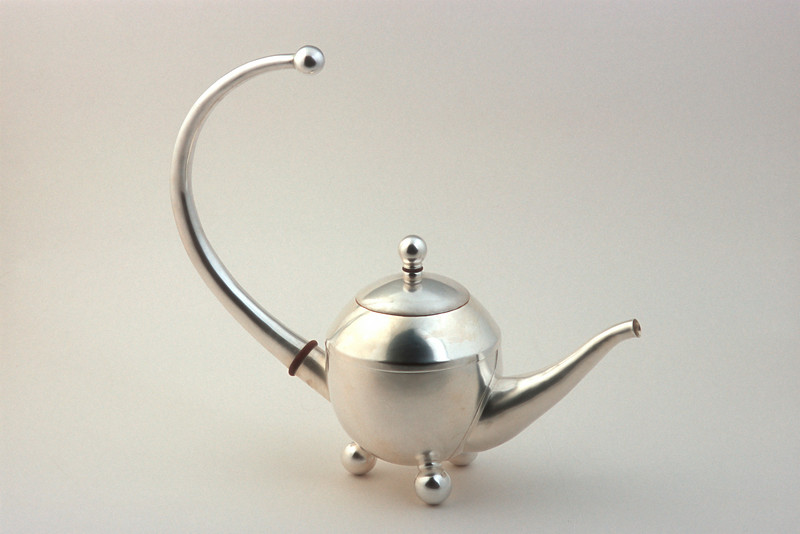 "Fully functional sterling silver teapot. 13""h 15""w 6""d"