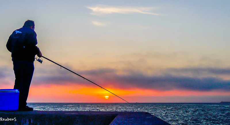 Fisherman catching sunset.jpg