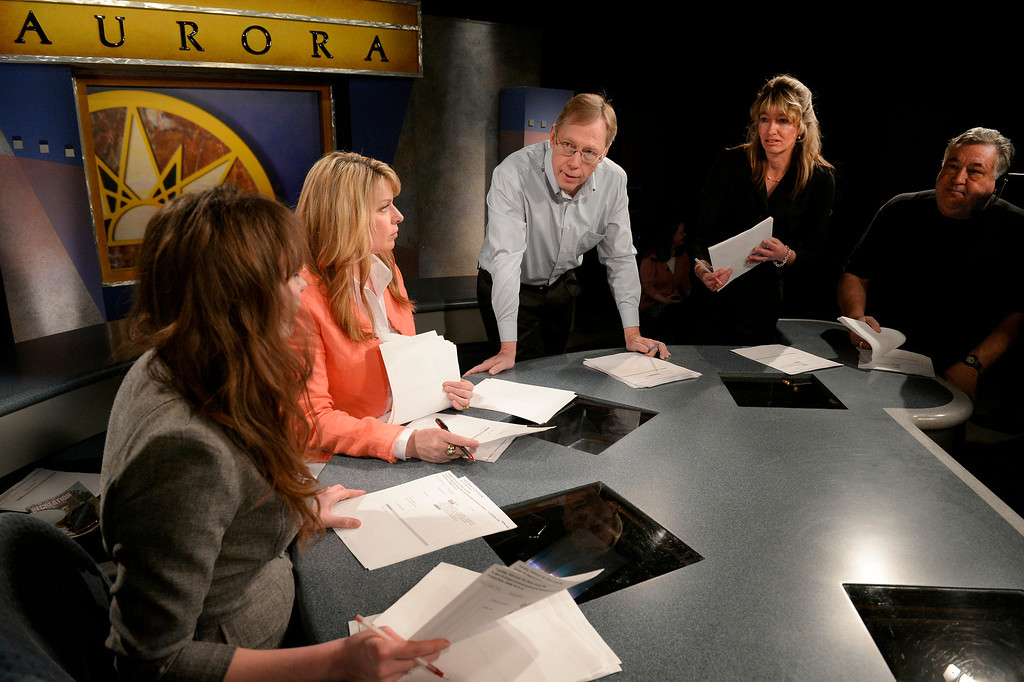 . AURORA, CO. - FEBRUARY 18: (l-r) Anchors Amanda Turner and Wendy Brockman talk with Production Supervisor Randy Simpson, News Director Yasmine Marino and Floor Director Ray Stallkamp before the taping of Aurora News Weekly in Aurora, CO February 18, 2014. The 30 minute news show is part of Aurora 8\'s public access programming. (Photo By Craig F. Walker / The Denver Post)