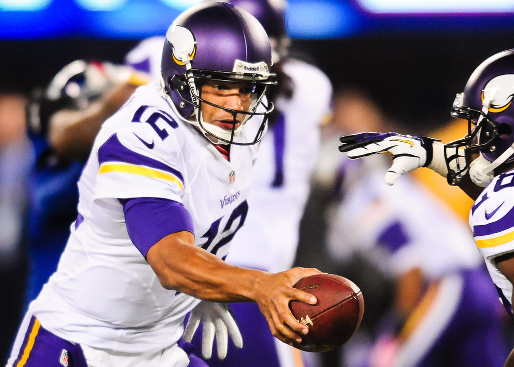 . Vikings quarterback Josh Freeman hands off to running back Adrian Peterson in the second quarter against the Giants. (Pioneer Press: Ben Garvin)