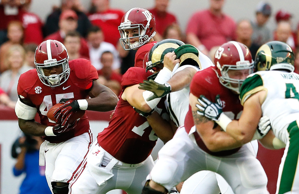 . TUSCALOOSA, AL - SEPTEMBER 21:  Jalston Fowler #45 of the Alabama Crimson Tide rushes against the Colorado State Rams at Bryant-Denny Stadium on September 21, 2013 in Tuscaloosa, Alabama.  (Photo by Kevin C. Cox/Getty Images)