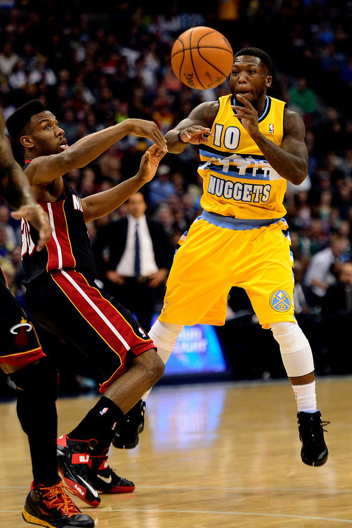 . Nate Robinson (10) of the Denver Nuggets passes as Norris Cole (30) of the Miami Heat defends during the first half of action.  (Photo by AAron Ontiveroz/The Denver Post)