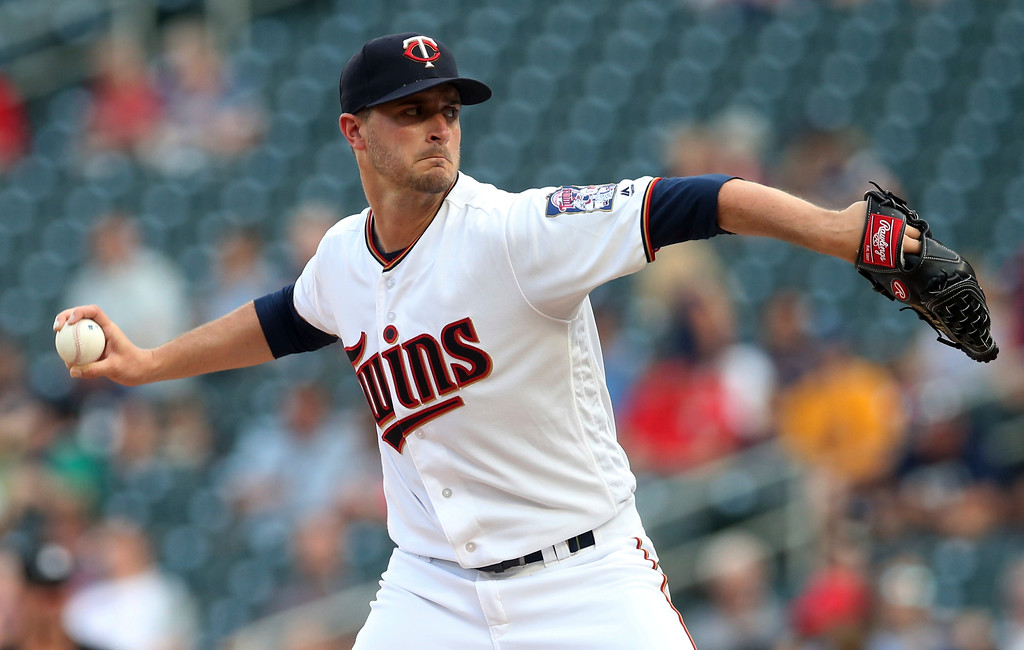 . Minnesota Twins pitcher Jake Odorizzi throws to a Cleveland Indians batter during the first inning of a baseball game Thursday, May 31, 2018, in Minneapolis. (AP Photo/Jim Mone)
