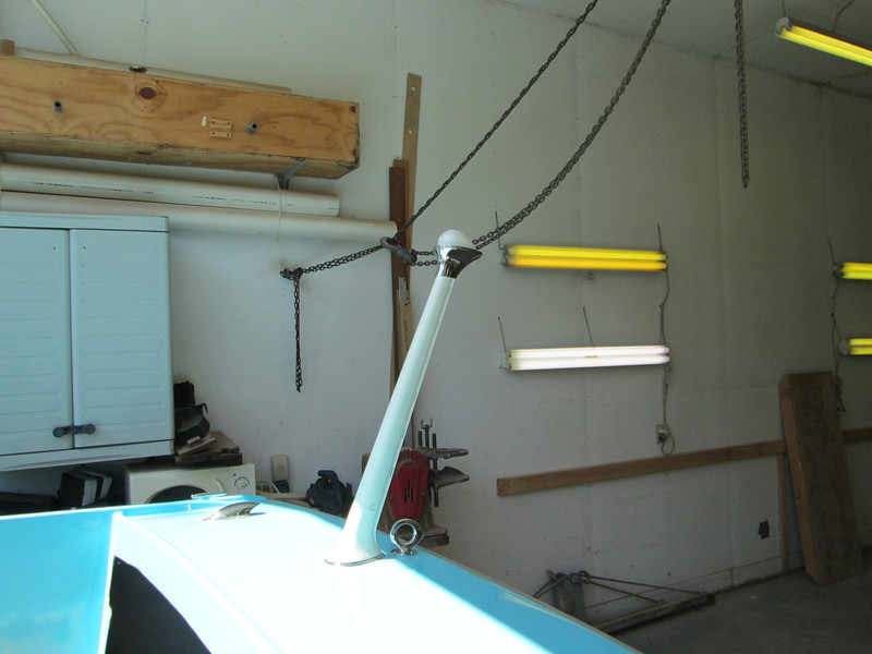 Stern flag pole with hardware and a new light lens installed.