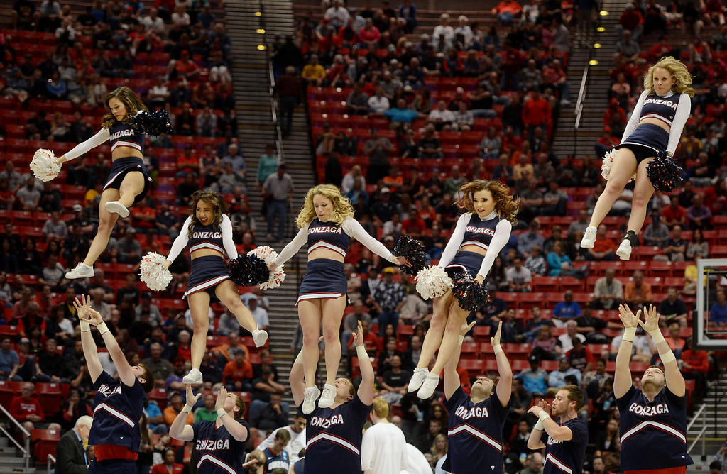 . The Gonzaga Bulldogs cheerleaders performs against the Arizona Wildcats during the third round of the 2014 NCAA Men\'s Basketball Tournament at Viejas Arena on March 23, 2014 in San Diego, California.  (Photo by Donald Miralle/Getty Images)