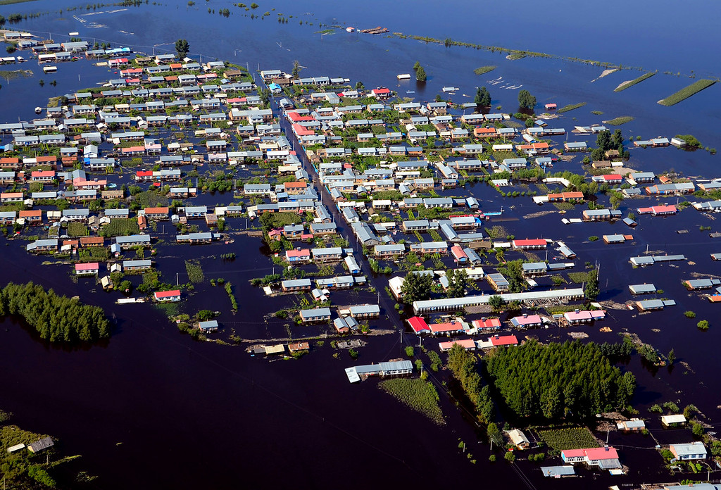 . Houses are inundated by deluge in Xiangyang town of Jiayin county in northeast China\'s Heilongjiang province. Heavy flooding in the extreme south and northeast has left more than 200 dead or missing in recent days. (AP Photo)