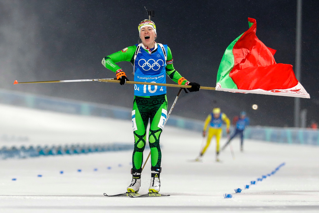 . Darya Domracheva, of Belarus, skis across the finish line for the gold medal during the women\'s 4x6-kilometer biathlon relay at the 2018 Winter Olympics in Pyeongchang, South Korea, Thursday, Feb. 22, 2018. (AP Photo/Andrew Medichini)