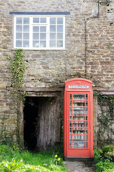 Rural phonebox library in Dorset, England