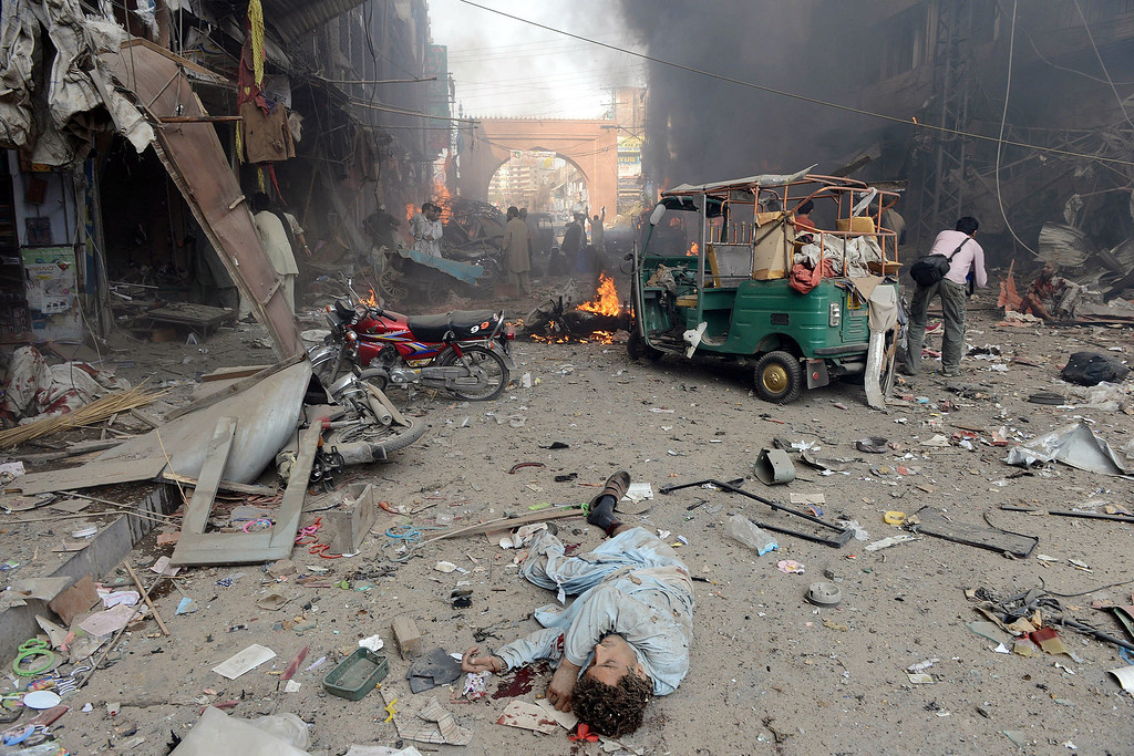 . The body of Pakistani blast victim lies at the site of a bomb explosion in the busy Kissa Khwani market in Peshawar on September 29, 2013.  AFP PHOTO / HASHAM AHMED/AFP/Getty Images