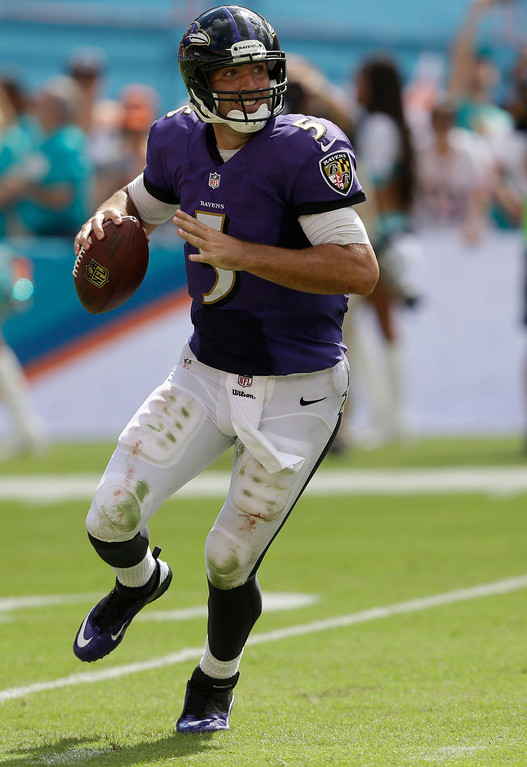 . Baltimore Ravens quarterback Joe Flacco (5) looks to pass during the second half of an NFL football game against the Miami Dolphins, Sunday, Oct. 6, 2013, in Miami Gardens, Fla. (AP Photo/Wilfredo Lee)