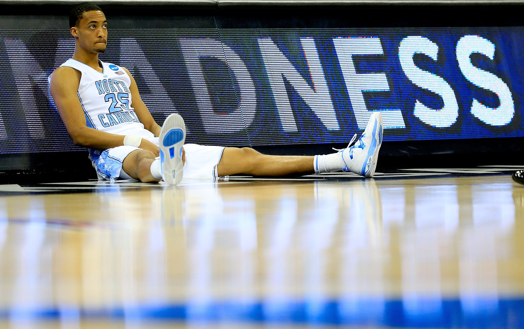 . KANSAS CITY, MO - MARCH 22: J.P. Tokoto #25 of the North Carolina Tar Heels waits to be substituted into the game in the first half against the Villanova Wildcats during the second round of the 2013 NCAA Men\'s Basketball Tournament at the Sprint Center on March 22, 2013 in Kansas City, Missouri.  (Photo by Jamie Squire/Getty Images)