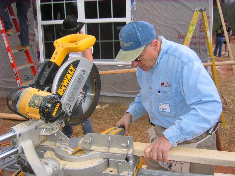 08 03-14 LeRoy Troyer of South Bend IN, chair of FCH board, lends a hand during 3-house build. lcf