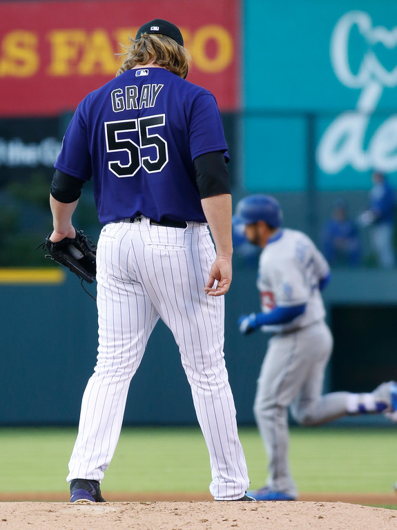 . Colorado Rockies starting pitcher Jon Gray, front, kicks at the mound as Los Angeles Dodgers\' Adrian Gonzalez circles the bases after hitting a solo home run in the first inning of a baseball game Friday, April 22, 2016, in Denver. (AP Photo/David Zalubowski)