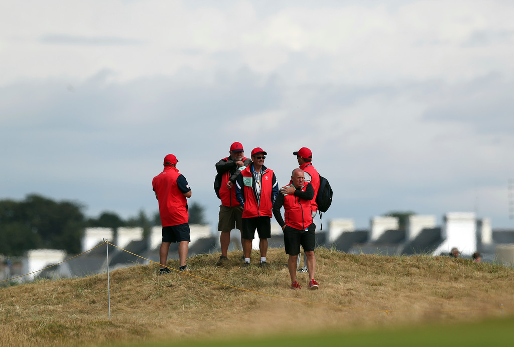 . Course marshals stand on the 6th hole during a practice round ahead of the British Open Golf Championship in Carnoustie, Scotland, Wednesday July 18, 2018. (AP Photo/Jon Super)