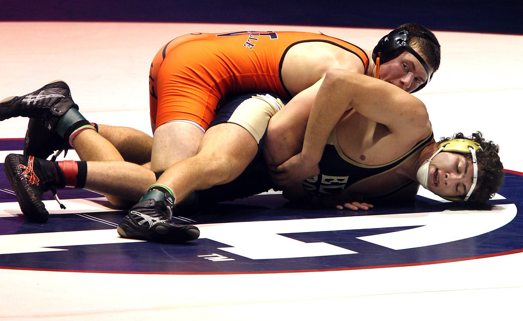 . Vacaville\'s Jeramy Sweany, top, wrestles against Elk Grove\'s Scott Votino in the 195-pound championship match during the California Interscholastic Federation wrestling championships in Bakersfield, Calif., on Saturday, March 2, 2013. Sweany would go onto win 6-1.(Anda Chu/Staff)