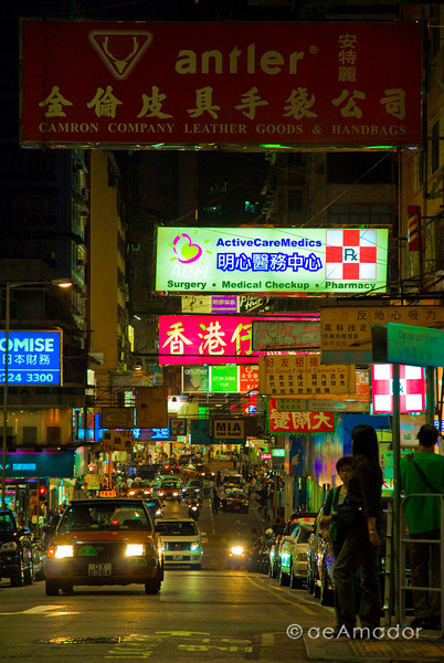 aeamador©-HK08_DSC0144      Hong Kong. Kowloon. Tsim Sha Tsui. Though not to be compared with what you find in Hong Kong island, it is quite a vibrant and lively city. People fill up the streets and sidewalks day and night for shopping, entertainment and more. Signs make a great show, especially at night, giving vibrancy and character to the city.