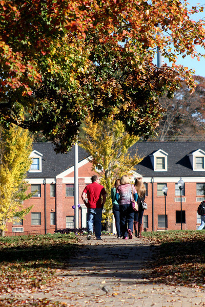 A group of people touring the Gardner-Webb University campus on a Fall day.