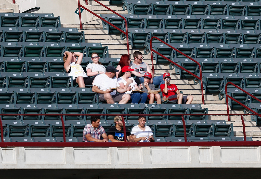 . Fans brave the heat during a baseball game between the Texas Rangers and the Cleveland Indians, Saturday, July 21, 2018, in Arlington, Texas. (AP Photo/Jim Cowsert)