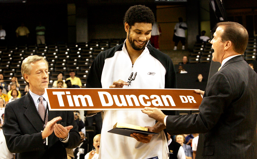 . Winston-Salem, N.C. Mayor Allen Joines, left, and Wake Forest athletic director Ron Wellman present San Antonio Spurs\' Tim Duncan a street sign in his honor before a preseason game against the Washington Wizards, Thursday, Oct. 13, 2005, in Winston-Salem, NC. Duncan played for Wake Forest between 1993 and 1997. (AP Photo/Lynn Hey)