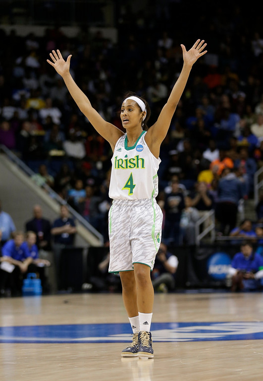 . Notre Dame guard Skylar Diggins celebrates a teammate\'s 3-point basket during the second half of the regional final of the NCAA women\'s college basketball tournament Tuesday, April 2, 2013, in Norfolk, Va. Notre Dame won 87-76. (AP Photo/Steve Helber)