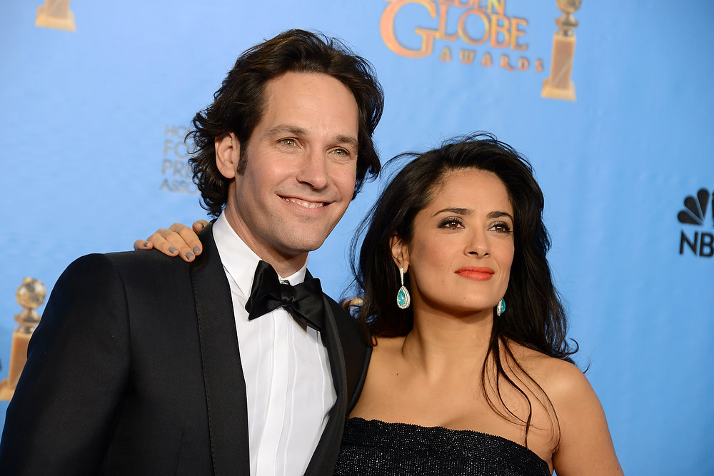 Description of . Presenters Paul Rudd, left, and Salma Hayek pose backstage at the 70th Annual Golden Globe Awards at the Beverly Hilton Hotel on Sunday Jan. 13, 2013, in Beverly Hills, Calif. (Photo by Jordan Strauss/Invision/AP)