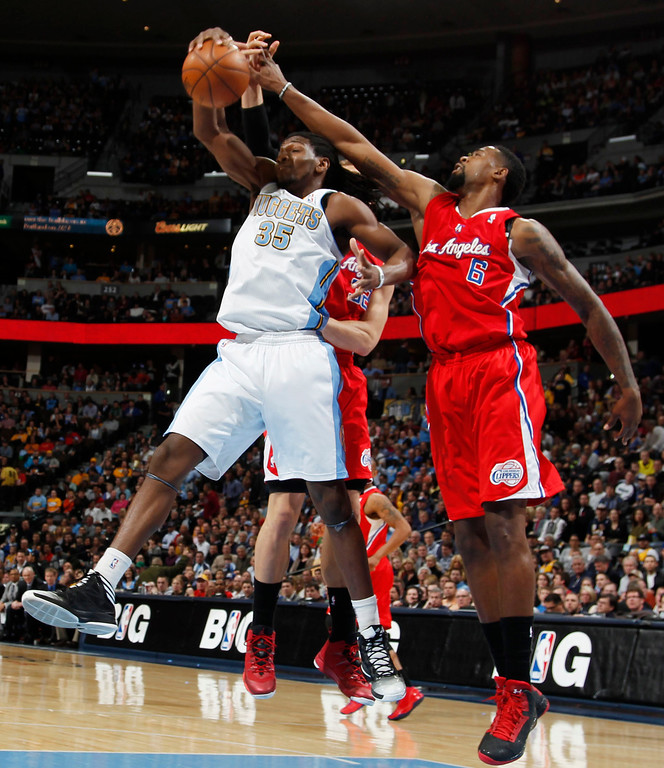 . Denver Nuggets forward Kenneth Faried, left, battles for control of a rebound with Los Angeles Clippers forward Blake Griffin, center, and center DeAndre Jordan in the first quarter of  an NBA basketball game in Denver, Thursday, March 7, 2013. (AP Photo/David Zalubowski)