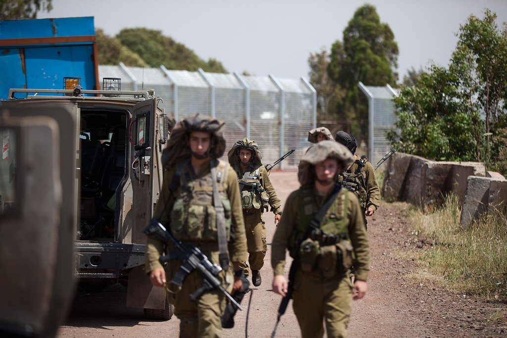 . GOLAN HEIGHTS - MAY 07:  Israeli soldiers patrol next to the border fence May 7, 2013 on border with Syria, in the Israeli-annexed Golan Heights. Syria has accused Israel of launching a series of airstrikes on targets near the Lebanon/Syria border, including an arms shipment and the Jamraya research centre, that was thought to produce chemical weapons.  (Photo by Uriel Sinai/Getty Images)