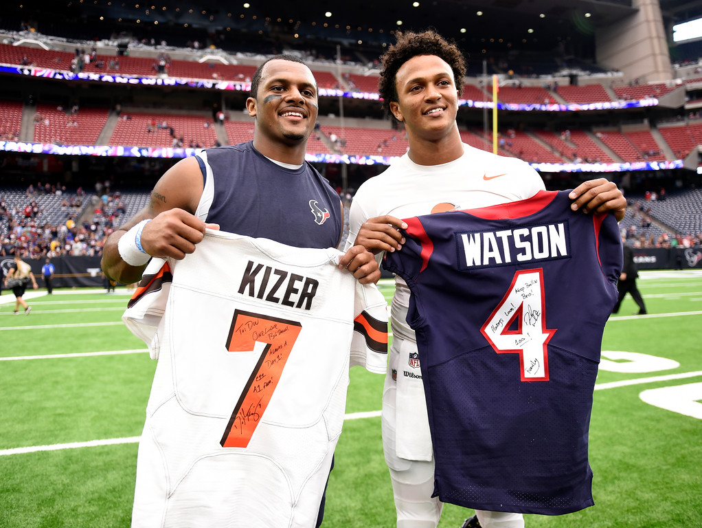 . Houston Texans quarterback Deshaun Watson, left, and Cleveland Browns quarterback DeShone Kizer, right, swap jerseys after their NFL football game, Sunday, Oct. 15, 2017, in Houston. (AP Photo/Eric Christian Smith)