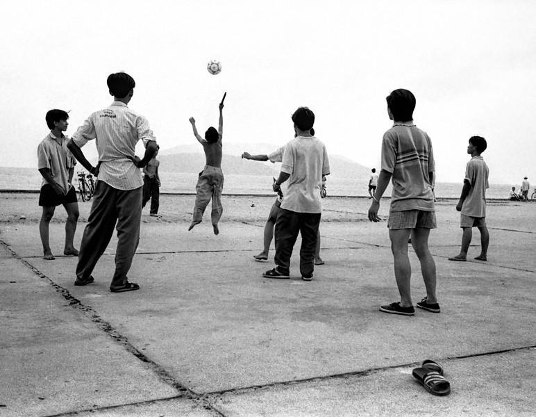 Boys playing near the North China Sea.tifBlurb.JPG