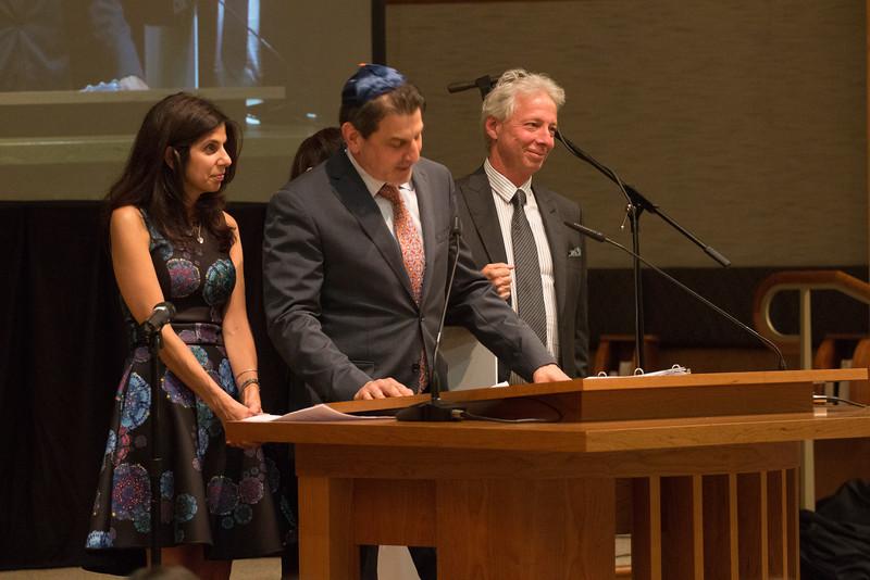Carolyn Weinberg, Margie Hoffman (hidden), Paul Weinberg, Joe Hoffman make the Congregational presentation -- Tour de Rudolph -- Retirement tribute for Rabbi Bill Rudolph, Congregation Beth El, Bethesda, MD, May 17, 2015
