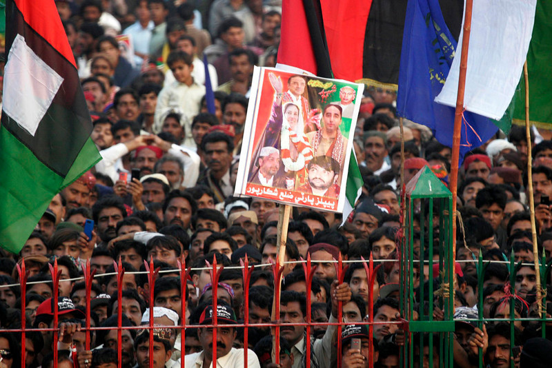 . Pakistan Peoples Party (PPP) supporters gather to listen to the speech of Bilawal Bhutto Zardari, son of assassinated former Pakistani prime minister Benazir Bhutto, to launch his political career during the fifth anniversary of his mother\'s death, at the Bhutto family mausoleum in Garhi Khuda Bakhsh, near Larkana December December 27, 2012. Benazir Bhutto was killed in a gun and suicide bomb attack after an election rally in the city of Rawalpindi on December 27, 2007, weeks after she returned to Pakistan after years in self-imposed exile. REUTERS/Nadeem Soomro