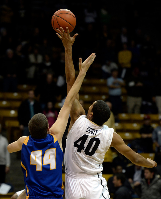 . University of Colorado\'s Josh Scott wins the tip-off against Sam Beeler during a game against  the University of California Santa Barbara, on Nov. 20, at the Coors Event Center in Boulder. (Jeremy Papasso/Boulder Daily Camera)