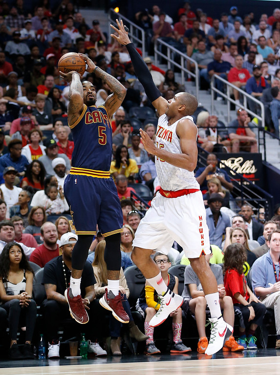 . Cleveland Cavaliers guard J.R. Smith (5) shoots against Atlanta Hawks center Al Horford (15) in the second half  of Game 4 of the second-round NBA basketball playoff series, Sunday, May 8, 2016, in Atlanta. (AP Photo/John Bazemore)