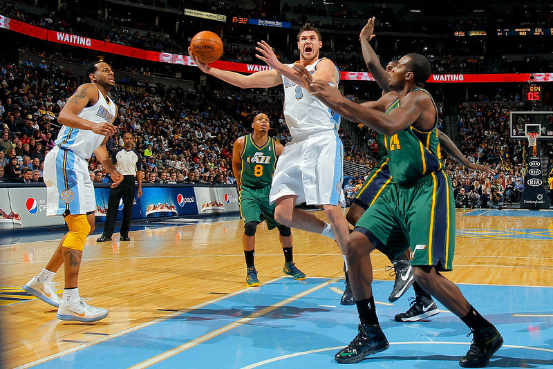 . Danilo Gallinari #8 of the Denver Nuggets lays up a shot against Paul Millsap #24 of the Utah Jazz at the Pepsi Center on January 5, 2013 in Denver, Colorado. The Nuggets defeated the Jazz 110-91. (Photo by Doug Pensinger/Getty Images)