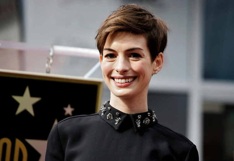 . Actress Anne Hathaway arrives at ceremonies honoring actor Hugh Jackman with a star on the Hollywood Walk of Fame in Hollywood, California, December 13, 2012. REUTERS/Jonathan Alcorn