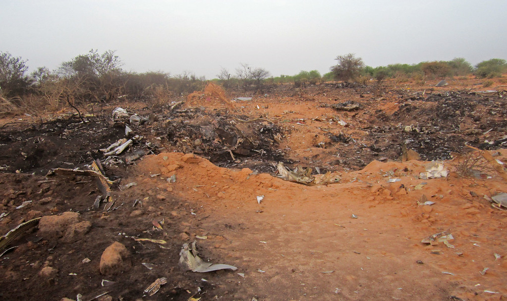 . This photo provided on Friday, July 25, 2014,  by the Burkina Faso Military shows the site of the plane crash in Mali. French soldiers secured a black box from the Air Algerie wreckage site in a desolate region of restive northern Mali on Friday, the French president said. Terrorism hasn\'t been ruled out as a cause, although officials say the most likely reason for the catastrophe that killed all onboard is bad weather. (AP Photo/Burkina Faso Military)