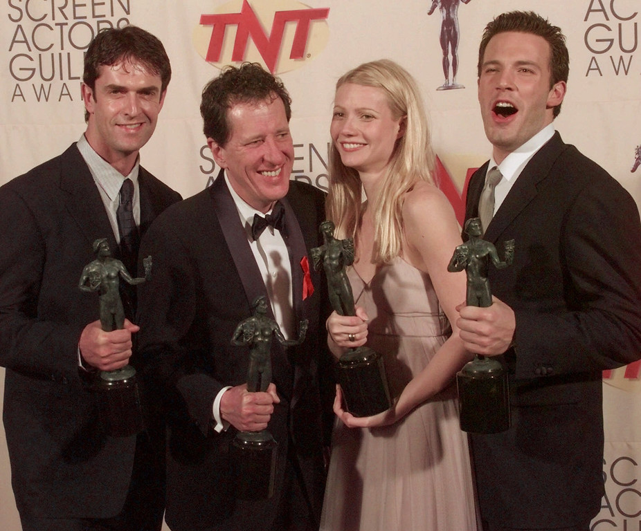 ". ""Shakespeare in Love,\"" cast members, from left, Rupert Everett, Geoffrey Rush, Gwyneth Paltrow and Ben Affleck display their awards for outstanding performance in a theatrical motion picture at the 5th Annual Screen Actors Guild Awards in Los Angeles, Calif., Sunday, March 7, 1999. (AP Photo/Reed Saxon)"