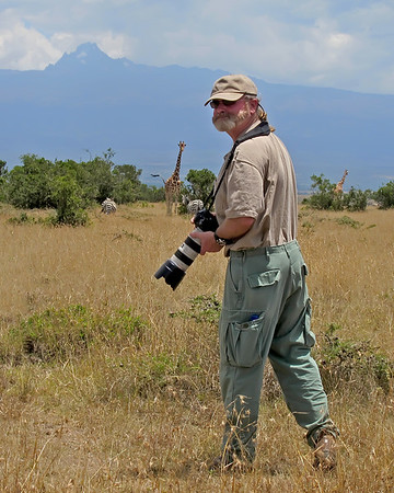 On walking safari in Kenya, Africa with  Mount Kenya and giraffes in background.  (photo by Carole Conger, 3/11)