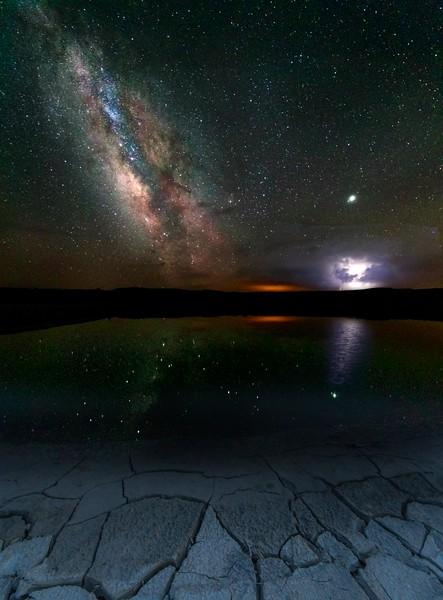 Milky Way Meets Lightning Strikes