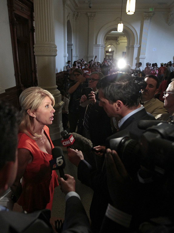 . Sen. Wendy Davis, D-Ft. Worth is interviewed after the first day of the second legislative special session called by Gov. Rick Perry on July 1, 2013 in Austin, Texas. This is the first day of a second legislative special session called by Texas Gov. Rick Perry to pass a restrictive abortion law through the Texas legislature. The first attempt was defeated after opponents of the law were able to stall the vote until after first special session had ended.  (Photo by Erich Schlegel/Getty Images)