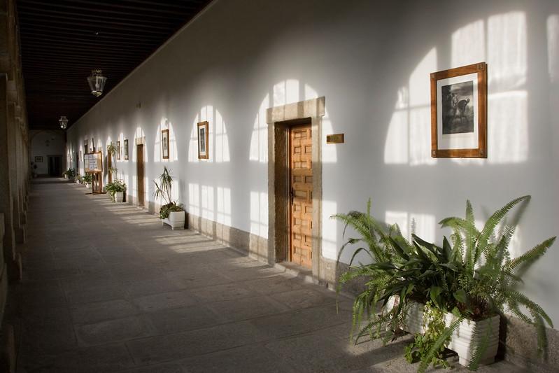 The light from glazed window on the wall of an old corridor, San Lorenzo de El Escorial, Madrid, Spain