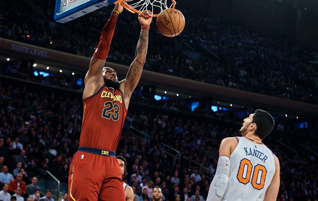 . Cleveland Cavaliers\' LeBron James, left, dunks over New York Knicks\' Enes Kanter (00) during the first half of a NBA basketball game at Madison Square Garden in New York, Monday, Nov. 13, 2017. (AP Photo/Andres Kudacki)