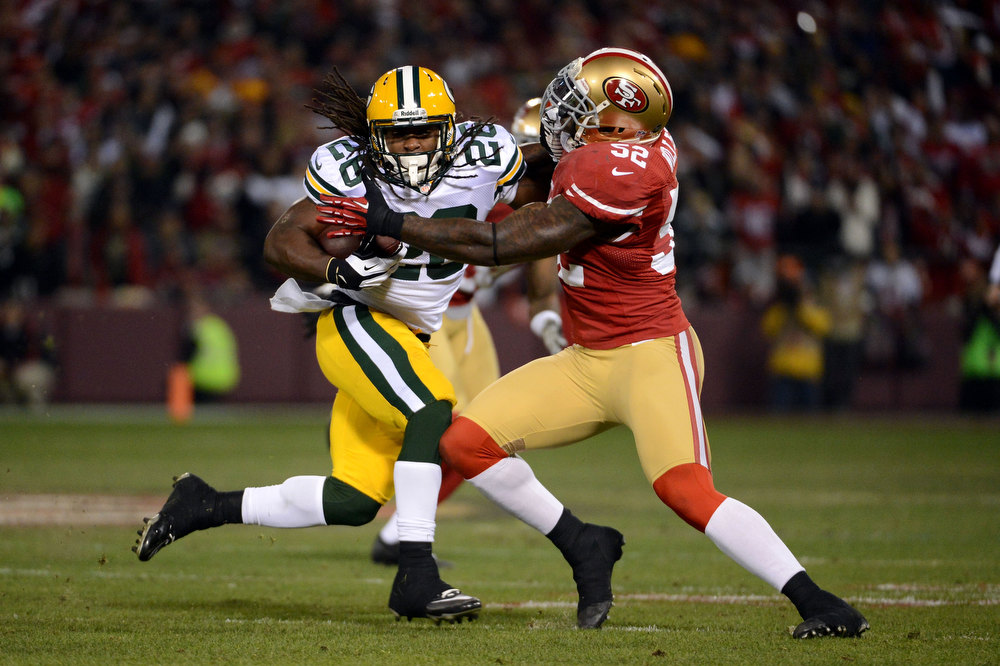 Description of . Running back DuJuan Harris #26 of the Green Bay Packers runs the ball inside linebacker Patrick Willis #52 of the San Francisco 49ers during the NFC Divisional Playoff Game at Candlestick Park on January 12, 2013 in San Francisco, California.  (Photo by Harry How/Getty Images)