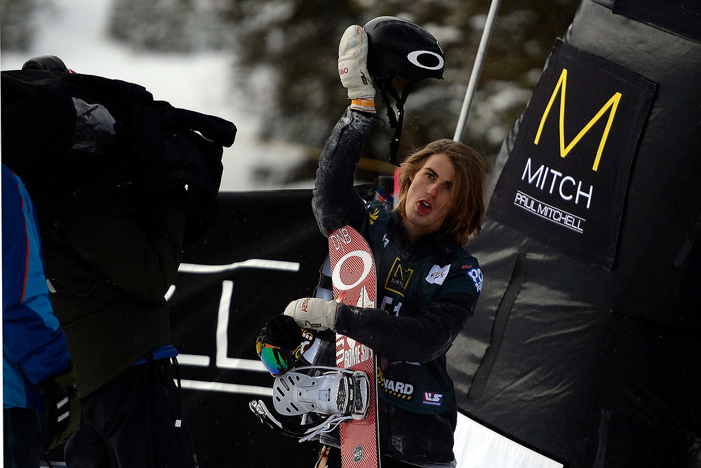 . Champion Staale Sandbech holds his helmet up in celebration after his title run during the slopestyle finals of the Copper Mountain Grand Prix.  (Photo by AAron Ontiveroz/The Denver Post)