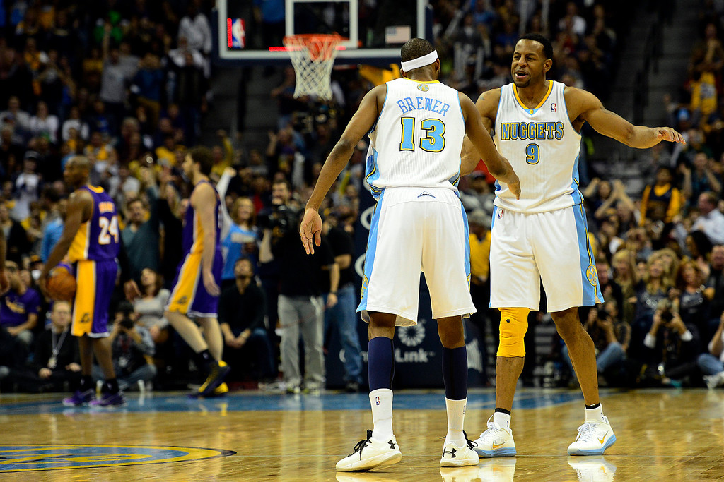 . Denver Nuggets small forward Corey Brewer (13) celebrates a three pointer with shooting guard Andre Iguodala (9) against the Los Angeles Lakers during the second half of the Nuggets\' 126-114 win at the Pepsi Center on Wednesday, December 26, 2012. AAron Ontiveroz, The Denver Post